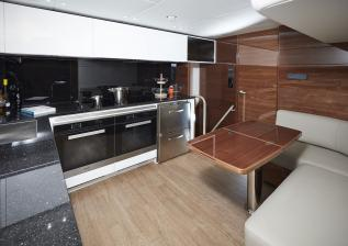 04-30m-hull-4-interior-galley-american-walnut-gloss.jpg