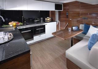 30m-interior-galley-american-walnut-gloss.jpg