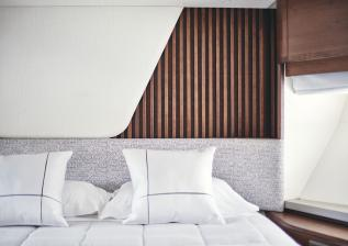 y85-interior-forward-guest-cabin-headboard-walnut-satin.jpg