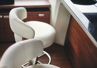 y85-interior-galley-bar-stools-detail-walnut-satin.jpg
