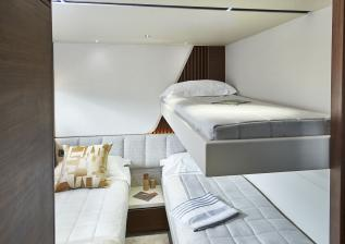 y85-interior-starboard-guest-cabin-with-pullman-bunk-walnut-satin.jpg