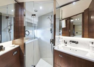 y78-interior-forward-cabin-bathroom-walnut-satin.jpg