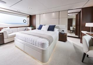 y78-interior-owners-stateroom-walnut-satin.jpg