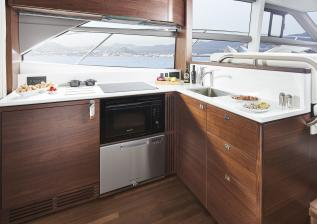 f50-interior-galley-walnut-satin.jpg