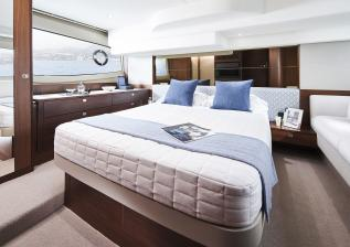 f50-interior-owners-stateroom-walnut-satin.jpg