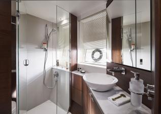 s66-interior-forward-cabin-bathroom-walnut-satin.jpg