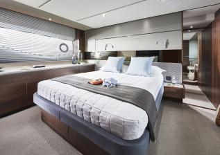 s66-interior-owners-stateroom-walnut-satin.jpg