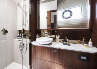 s62-interior-owners-stateroom-bathroom-walnut-satin.jpg