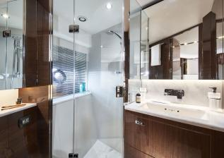 v78-interior-forward-cabin-bathroom-walnut-gloss.jpg