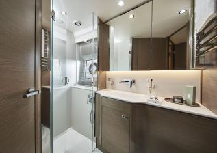 v55-interior-forward-cabin-bathroom-silver-oak-satin.jpg