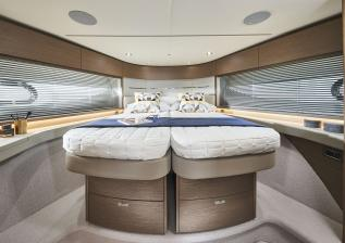 v55-interior-forward-guest-cabin-double-bed-silver-oak-satin.jpg