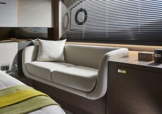 v55-interior-owners-stateroom-sofa-silver-oak-satin.jpg
